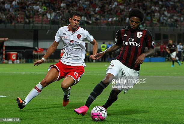 Luiz Adriano of AC Milan is challenged by Marco Rossi of AC Perugia during the TIM Cup match between AC Milan and AC Perugia at Stadio Giuseppe...