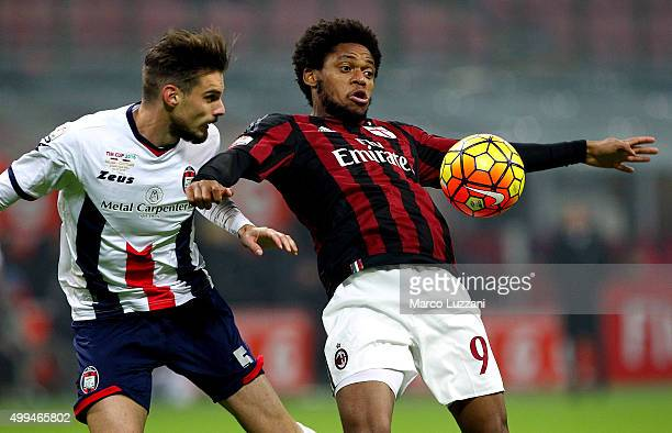 Luiz Adriano of AC Milan is challenged by Michele Cremonesi of FC Crotone during the TIM Cup match between AC Milan and FC Crotone at Stadio Giuseppe...