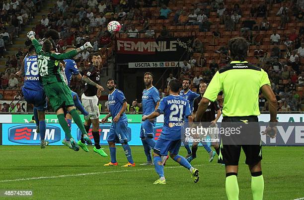 Luiz Adriano of AC Milan scores his goal during the Serie A match between AC Milan and Empoli FC at Stadio Giuseppe Meazza on August 29 2015 in Milan...