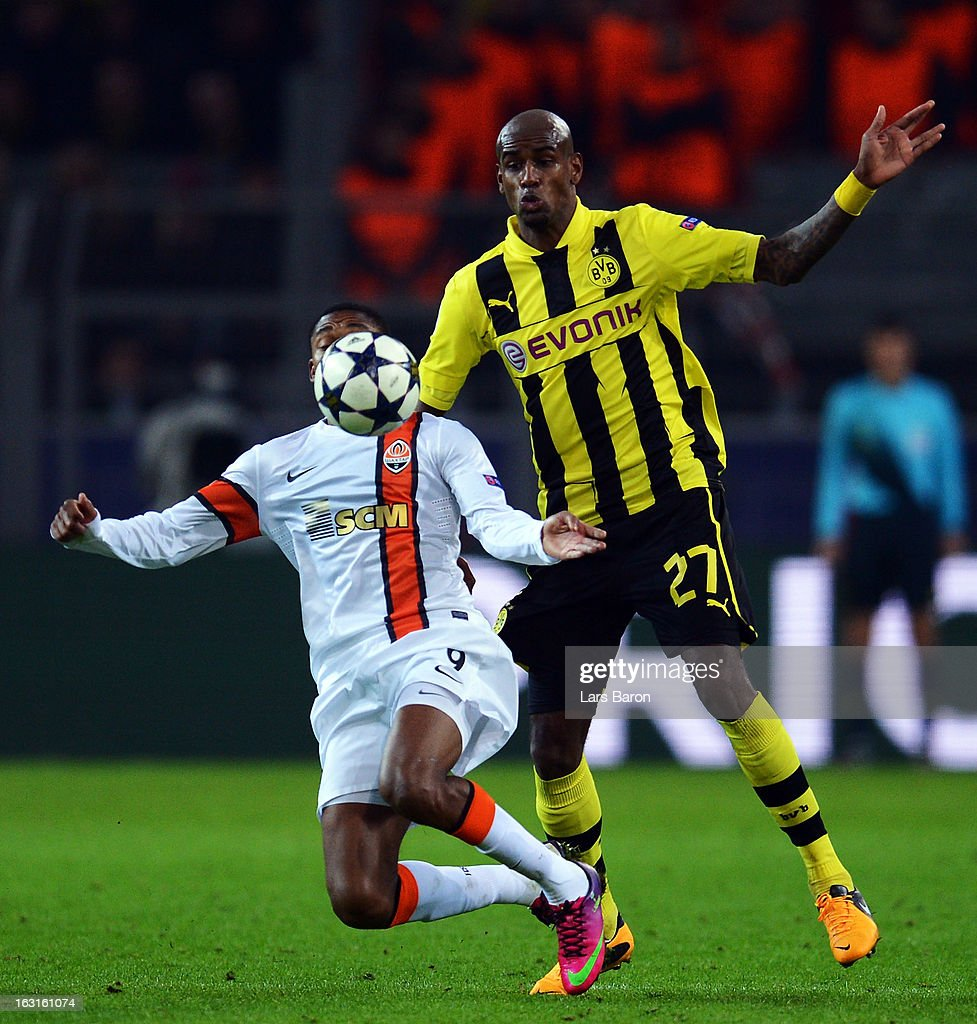 Luiz Adriano of Donetsk is challenged by Felipe Santana of Dortmund during the UEFA Champions League round of 16 second leg match between Borussia Dortmund and Shakhtar Donetsk at Signal Iduna Park on March 5, 2013 in Dortmund, Germany.
