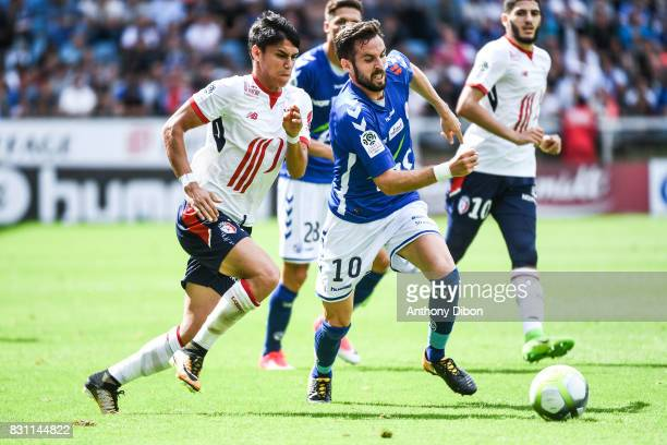 Luiz De Araujo of Lille and Benjamin Corgnet of Strasbourg during the Ligue 1 match between Racing Club Strasbourg and Lille OSC at Stade de la...