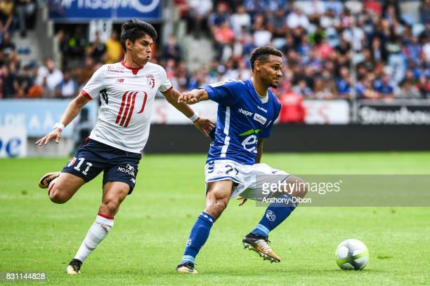 Luiz De Araujo of Lille and Kenny Lala of Strasbourg during the Ligue 1 match between Racing Club Strasbourg and Lille OSC at Stade de la Meinau on...