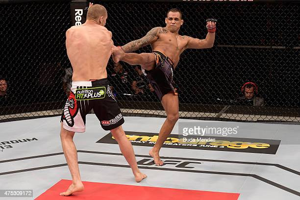 Luiz Dutra of Brazil kicks Tom Breese of England in their welterweight UFC bout during the UFC Fight Night Condit v Alves at Arena Goiania on May 30...