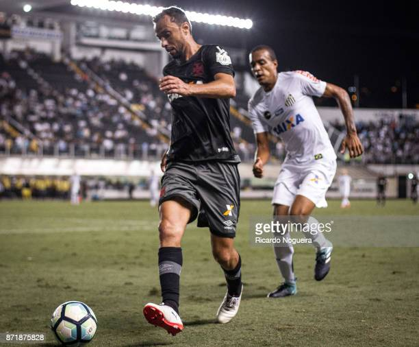 Luiz Felipe of Santos battles for the ball with Nene of Vasco during the match between Santos and Vasco da Gama as a part of Campeonato Brasileiro...