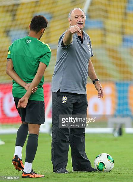 Luiz Felipe Scolari head coach of Brazil gives instructions to Neymar during a training session ahead of their FIFA Confederations Cup Brazil 2013...