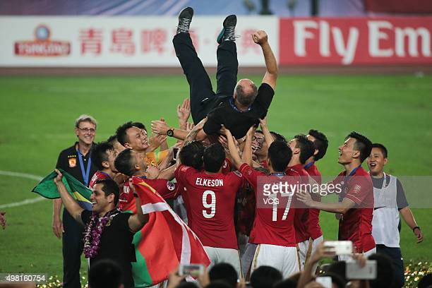 Luiz Felipe Scolari head coach of Guangzhou Evergrande is thrown in the air by his players as they celebrate after winning the second leg of the AFC...