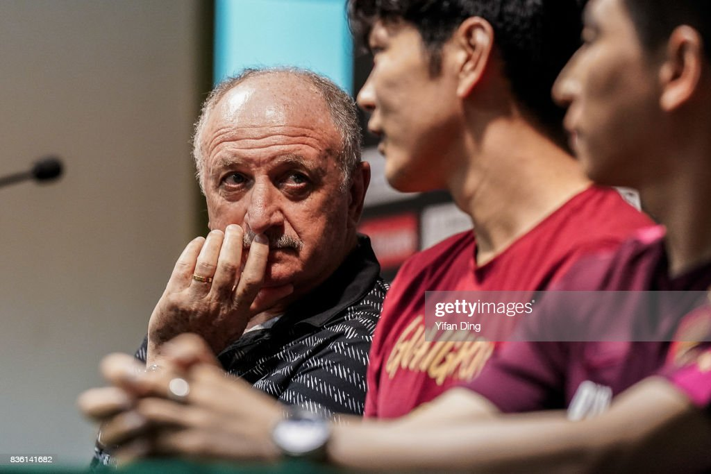 Luiz Felipe Scolari headcoach of Guangzhou Evergrande and Kim Young-Kwon of Guangzhou Evergrande react during pre-match press conference of the AFC Champions League 2017 Quarterfinals 1st leg between Shanghai SIPG v Guangzhou Evergrande at Shanghai Stadium on August 21, 2017 in Shanghai, China.