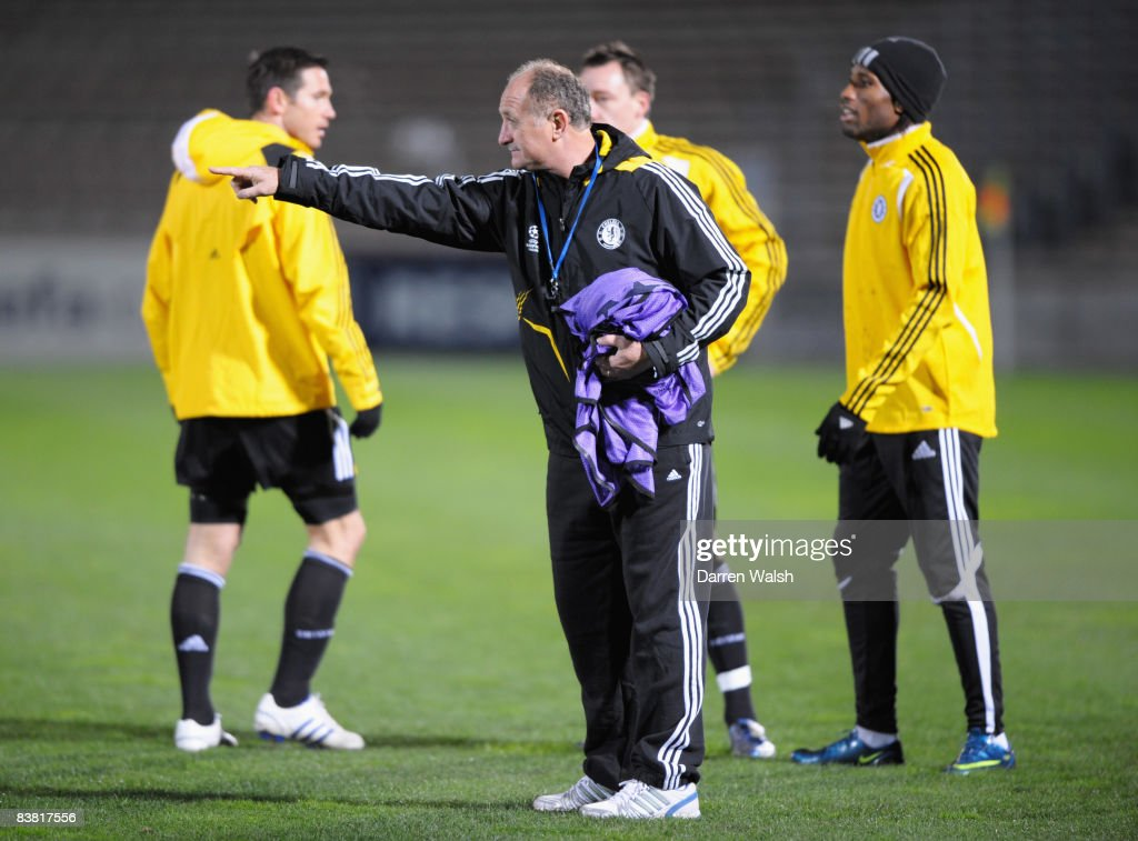 Luiz Felipe Scolari manager of Chelsea and Didier Drogba look on during a training session prior to the UEFA Champions League Group A match between...