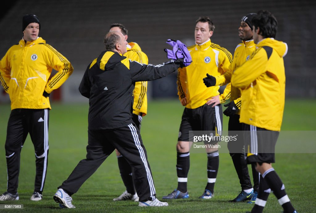 Luiz Felipe Scolari manager of Chelsea hands a bib to Didier Drogba during a training session prior to the UEFA Champions League Group A match...