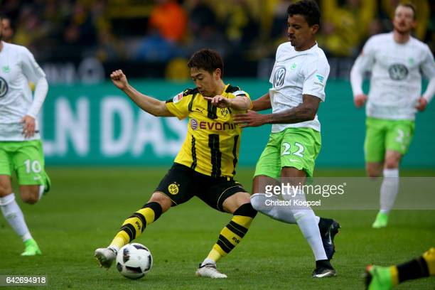 Luiz FGustavo of Wolfsburg challenges Shinji Kagawa of Dortmund during the Bundesliga match between Borussia Dortmund and VfL Wolfsburg at Signal...