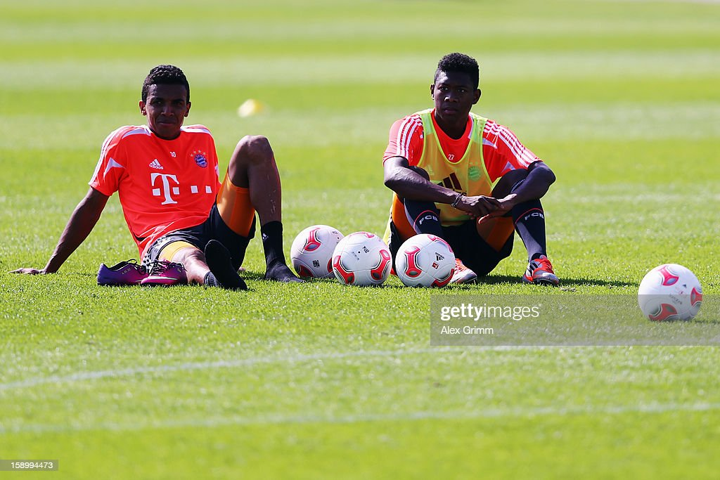 Luiz Gustavo (L) and David Alaba pause during a Bayern Muenchen training session at the ASPIRE Academy for Sports Excellence on January 5, 2013 in Doha, Qatar.