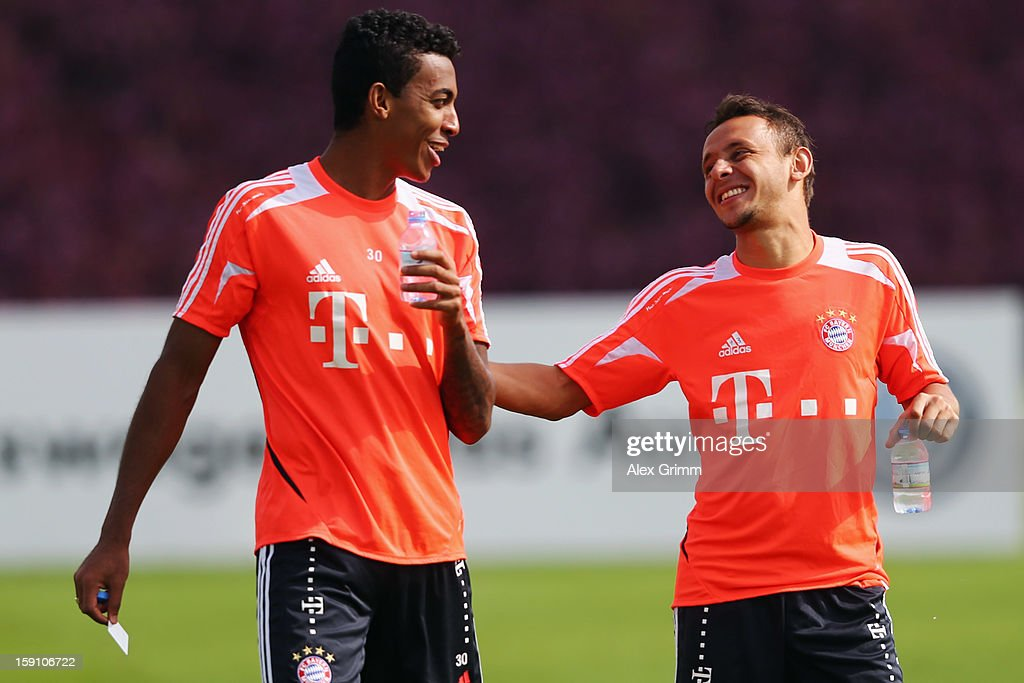 Luiz Gustavo (L) and Rafinha chat after a Bayern Muenchen training session at the ASPIRE Academy for Sports Excellence on January 8, 2013 in Doha, Qatar.