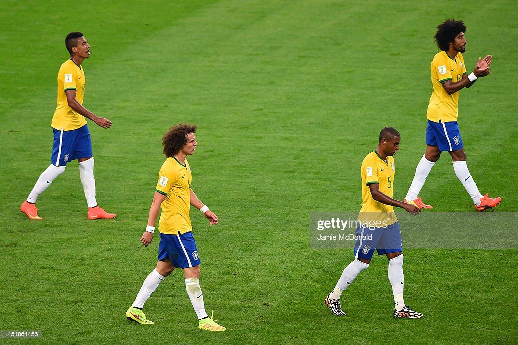 Luiz Gustavo David Luiz Fernandinho and Dante of Brazil look dejected after a goal during the 2014 FIFA World Cup Brazil Semi Final match between...