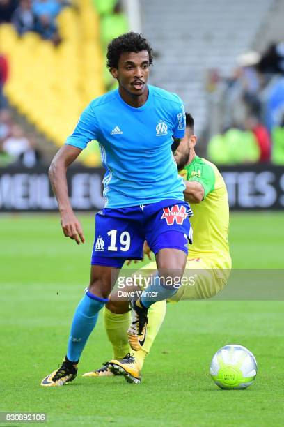Luiz Gustavo Dias of Marseille and Adrien Thomasson of Nantes during the Ligue 1 match between FC Nantes and Olympique Marseille at Stade de la...