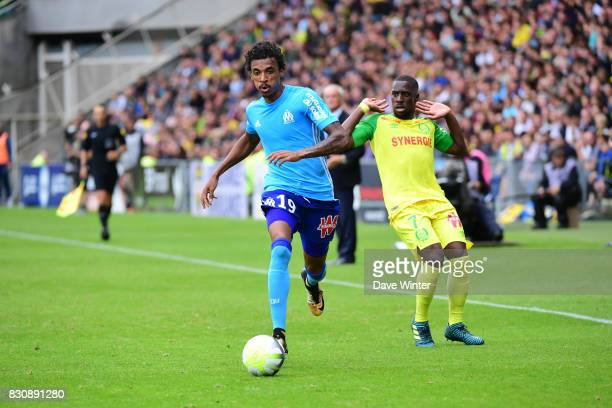 Luiz Gustavo Dias of Marseille and Jules Iloki of Nantes during the Ligue 1 match between FC Nantes and Olympique Marseille at Stade de la Beaujoire...