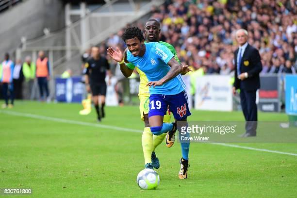 Luiz Gustavo Dias of Marseille beats Jules Iloki of Nantes during the Ligue 1 match between FC Nantes and Olympique Marseille at Stade de la...