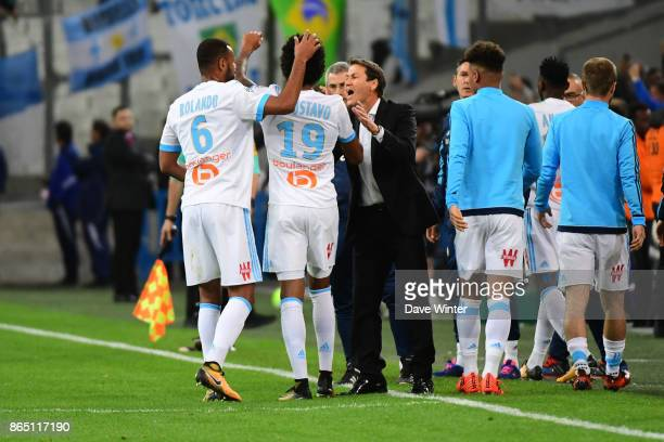 Luiz Gustavo Dias of Marseille is congratulated by Marseille coach Rudi Garcia after putting their side 10 ahead during the Ligue 1 match between...