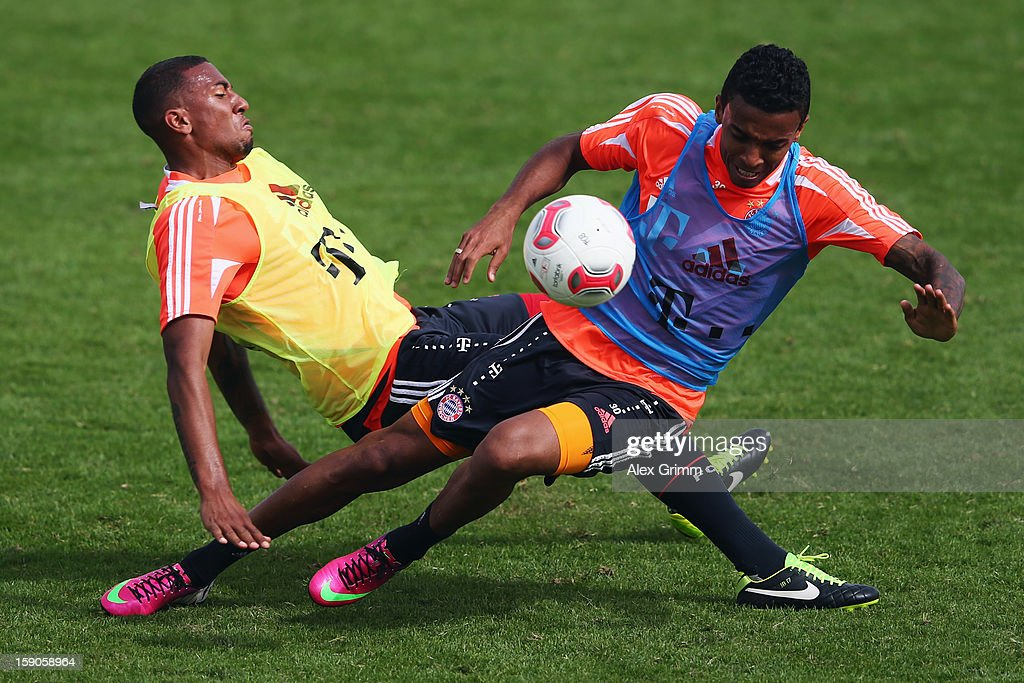 Luiz Gustavo (front) is challenged by <a gi-track='captionPersonalityLinkClicked' href=/galleries/search?phrase=Jerome+Boateng&family=editorial&specificpeople=2192287 ng-click='$event.stopPropagation()'>Jerome Boateng</a> during a Bayern Muenchen training session at the ASPIRE Academy for Sports Excellence on January 7, 2013 in Doha, Qatar.