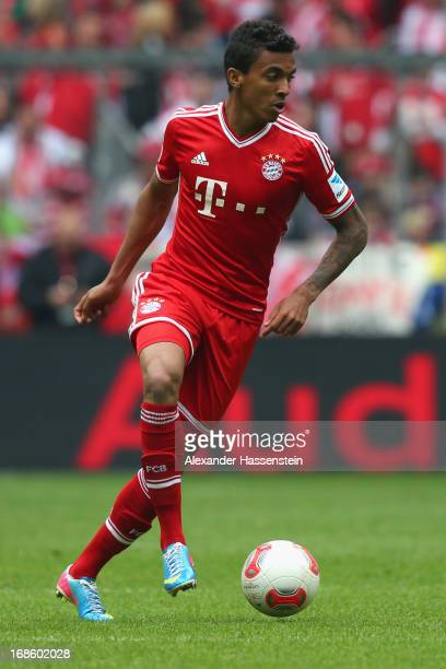 Luiz Gustavo of Bayern Muenchen runs with the ball during the Bundesliga match between FC Bayern Muenchen and FC Ausgburg at the Allianz Arena on May...