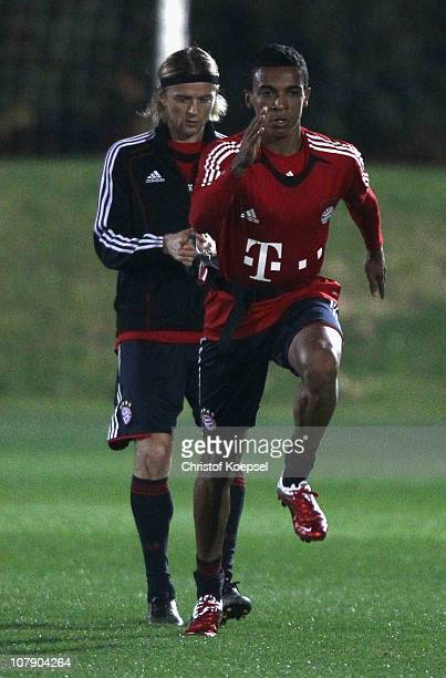Luiz Gustavo of Bayern pulls Anatoliy Tymoshchuk of Bayern during the FC Bayern Muenchen training session at Aspire Academy for Sports Excellence...