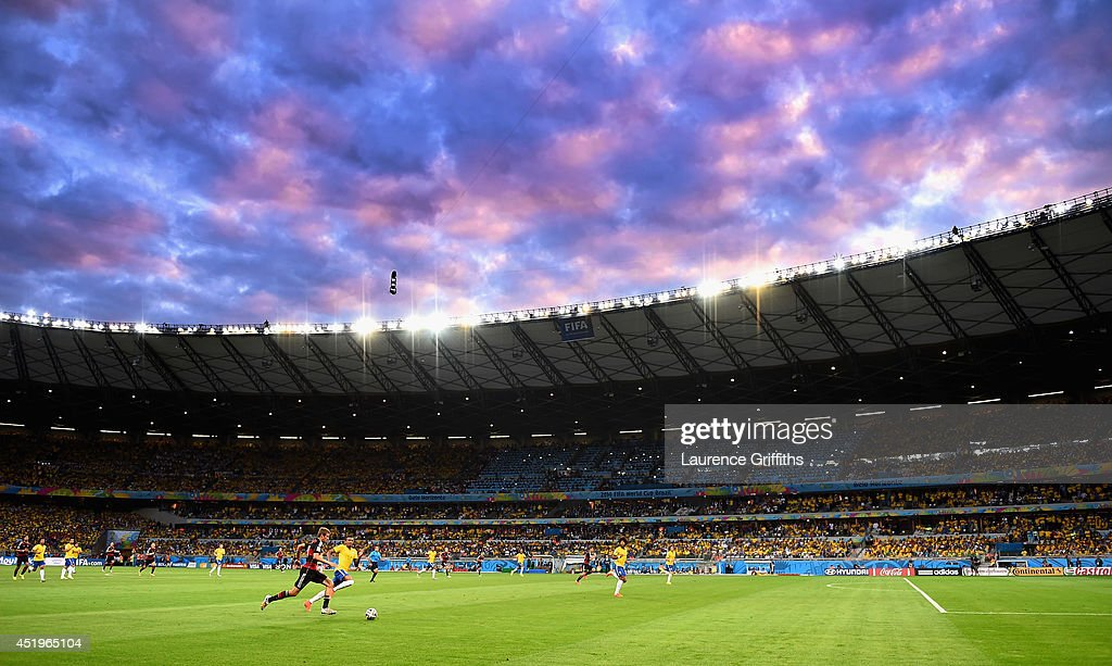 Luiz Gustavo of Brazil and Thomas Mueller of Germany during the 2014 FIFA World Cup Brazil Semi Final match between Brazil and Germanyat Estadio Mineirao on July 8, 2014 in Belo Horizonte, Brazil.