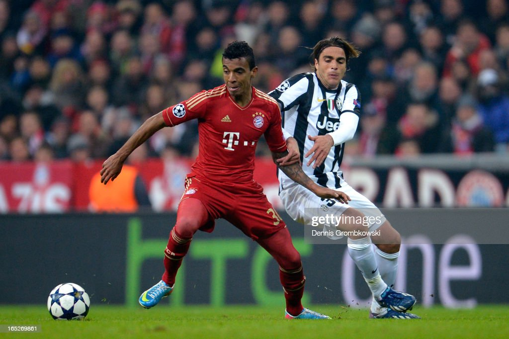 Luiz Gustavo of FC Bayern Muenchen and Alessandro Matri of Juventus battle for the ball during the UEFA Champions League quarter final first leg match between FC Bayern Muenchen and Juventus at Allianz Arena on April 2, 2013 in Munich, Germany.