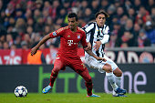 Luiz Gustavo of FC Bayern Muenchen and Alessandro Matri of Juventus battle for the ball during the UEFA Champions League quarter final first leg...