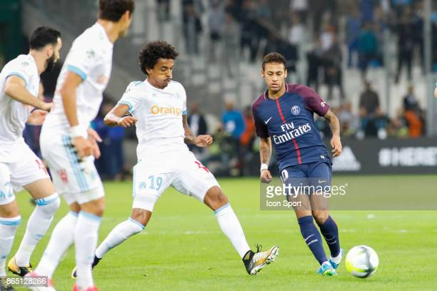 Luiz Gustavo of Marseille and Neymar of Paris during the Ligue 1 match between Olympique Marseille and Paris Saint Germain at Stade Velodrome on...