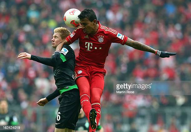Luiz Gustavo of Muenchen and Kevin de Bryne of Bremen head for the ball during the Bundesliga match between Bayern Muenchen and Werder Bremen at...