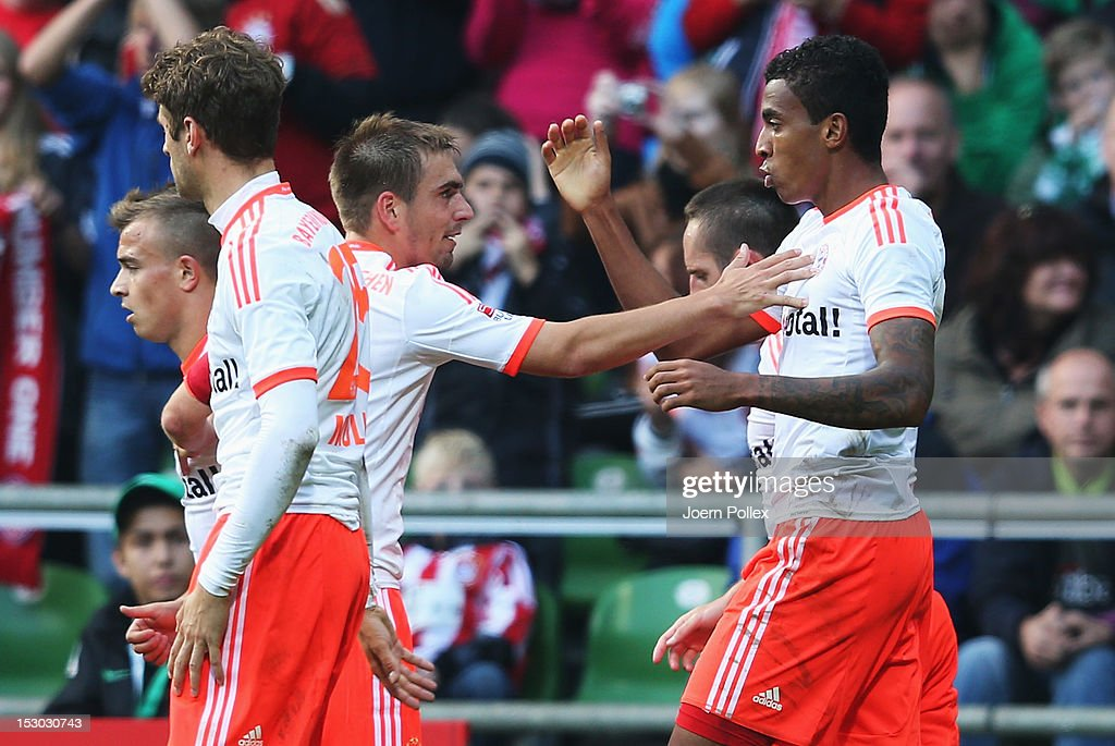 Luiz Gustavo (R) of Muenchen celebrates with his team mate <a gi-track='captionPersonalityLinkClicked' href=/galleries/search?phrase=Philipp+Lahm&family=editorial&specificpeople=483746 ng-click='$event.stopPropagation()'>Philipp Lahm</a> after scoring his team's first goal during the Bundesliga match between SV Werder Bremen and FC Bayern Muenchen at Weser Stadium on September 29, 2012 in Bremen, Germany.