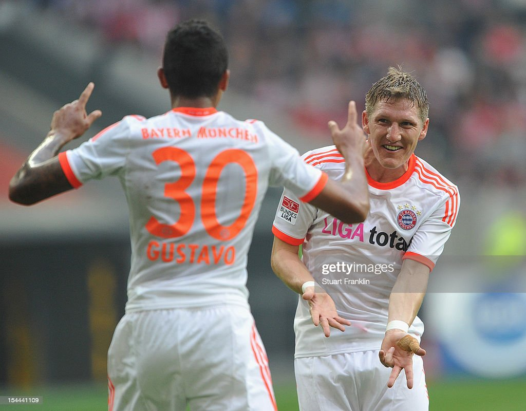 Luiz Gustavo of Munich celebrates scoring his goal with Bastian Schweinstieger during the Bundesliga match between Fortuna Duesseldorf 1895 and FC Bayern Muenchen at Esprit-Arena on October 20, 2012 in Duesseldorf, Germany.