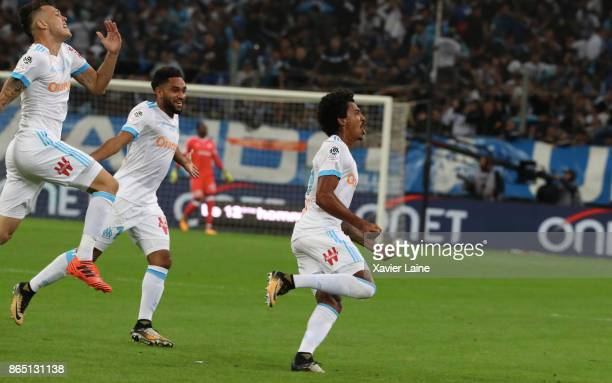 Luiz Gustavo of Olympique Marseille celebrate his goal with teammattes during the Ligue 1cmatch between Olympique Marseille and Paris Saint Germain...