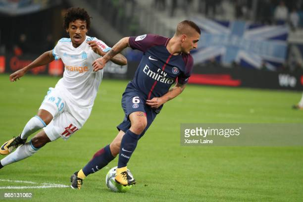Luiz Gustavo of Olympique Marseille in action with Marco Verratti of PSG during the Ligue 1match between Olympique Marseille and Paris Saint Germain...