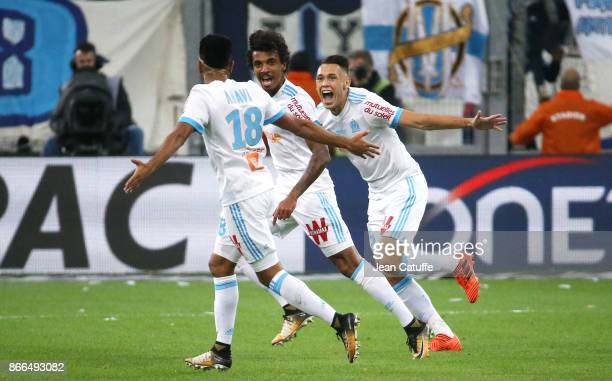 Luiz Gustavo of OM celebrates his goal between Jordan Amavi and Lucas Ocampos during the French Ligue 1 match between Olympique de Marseille and...