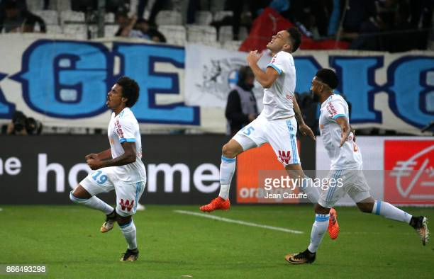 Luiz Gustavo of OM celebrates his goal with Lucas Ocampos and Jordan Amavi during the French Ligue 1 match between Olympique de Marseille and Paris...