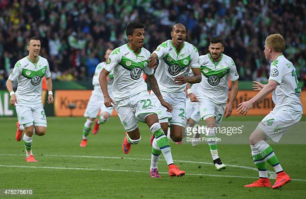 Luiz Gustavo of VfL Wolfsburg celebrates after scoring his teams first goal during the DFB Cup Final match between Borussia Dortmund and VfL...