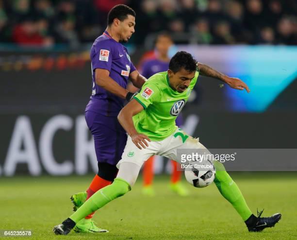 Luiz Gustavo of VfL Wolfsburg is challenged by Serge Gnabry of SV Werder Bremen during the Bundesliga match between VfL Wolfsburg and Werder Bremen...