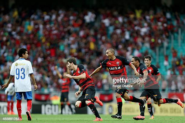 Luiz Gustavo of Vitoria celebrates his goal during the match between Vitoria and Bahia as part of Brasileirao Series A 2014 at Arena Fonte Nova on...