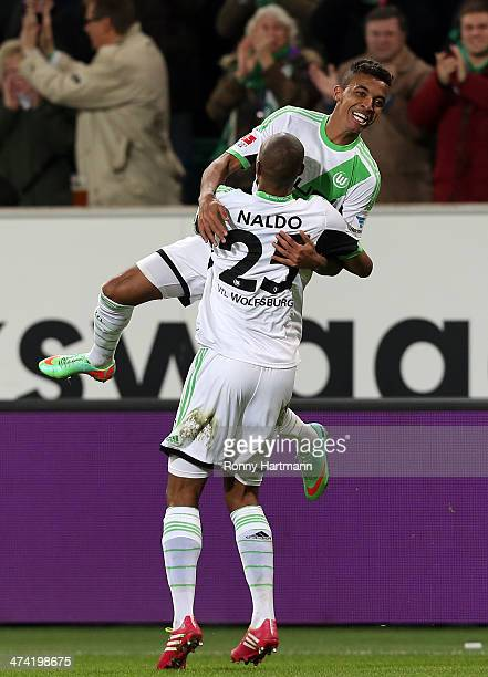 Luiz Gustavo of Wolfsburg celebrates scoring his team's second goal with Naldo of Wolfsburg during the Bundesliga match between VfL Wolfsburg and...