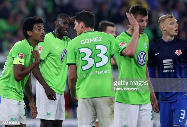 Luiz Gustavo of Wolfsburg discusses with Mario Gomez of Wolfsburg during the Bundesliga Playoff first leg match between VfL Wolfsburg and Eintracht...