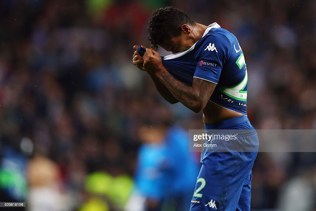 Luiz Gustavo of Wolfsburg reacts after the UEFA Champions league Quarter Final Second Leg match between Real Madrid and VfL Wolfsburg at Estadio Santiago Bernabeu on April 12, 2016 in Madrid, Spain.
