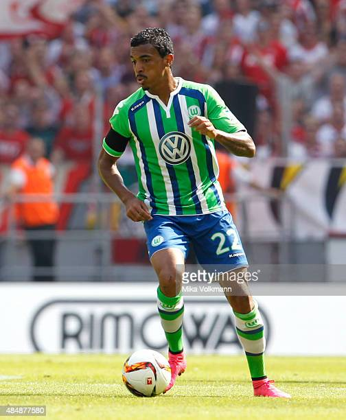 Luiz Gustavo of Wolfsburg runs with the ball during the Bundesliga match between 1 FC Koeln and VfL Wolfsburg at RheinEnergieStadion on August 22...