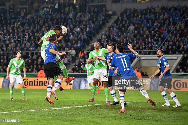 Luiz Gustavo of Wolfsburg scores his team's second goal during the DFB Cup Semi Final match between Arminia Bielefeld and VfL Wolfsburg at Schueco...