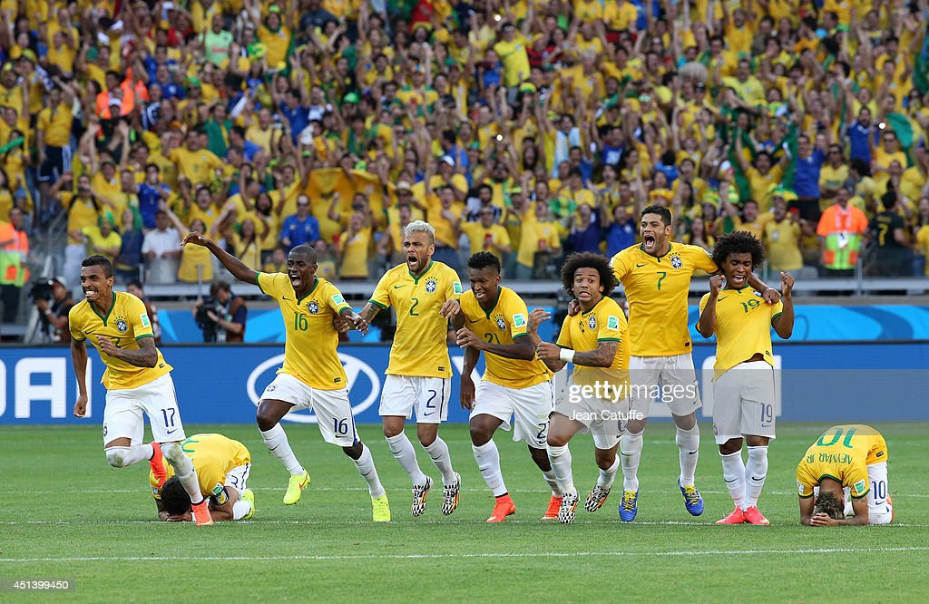 Luiz Gustavo, Ramires, <a gi-track='captionPersonalityLinkClicked' href=/galleries/search?phrase=Dani+Alves&family=editorial&specificpeople=2191863 ng-click='$event.stopPropagation()'>Dani Alves</a>, Jo, Marcelo, Hulk, <a gi-track='captionPersonalityLinkClicked' href=/galleries/search?phrase=Willian+-+Soccer+Player+for+Chelsea+and+Brazil&family=editorial&specificpeople=9886576 ng-click='$event.stopPropagation()'>Willian</a> and Neymar of Brazil celebrate the victory after the penalty shootout of the 2014 FIFA World Cup Brazil round of 16 match between Brazil and Chile at Estadio Mineirao on June 28, 2014 in Belo Horizonte, Brazil.