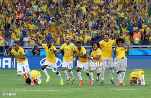 Luiz Gustavo Ramires Dani Alves Jo Marcelo Hulk Willian and Neymar of Brazil celebrate the victory after the penalty shootout of the 2014 FIFA World...
