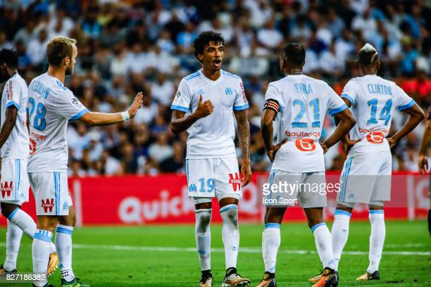 Luiz Gustavo speaks to Patrice Evra of Marseille during the Ligue 1 match between Olympique Marseille vs Dijon FCO at Stade Velodrome on August 6...