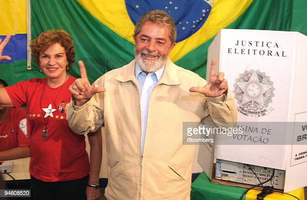 Luiz Inacio Lula da Silva president of Brazil and his wife Marisa gesture at their polling place in So Bernado do Campo near Sao Paulo Brazil October...