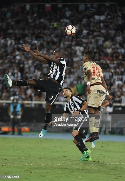 Luiz Ricardo Alves of Botafogo de Futebol e Regatas in action against Dario Aimar of Barcelona SC during Copa Libertadores of America match between...