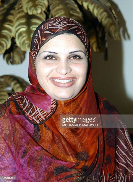 Lujaina Mohsen Darwish a candidate for Oman's upcoming Consultative Council elections poses at her home in Muscat 03 October 2003 Incumbent Darwish a...