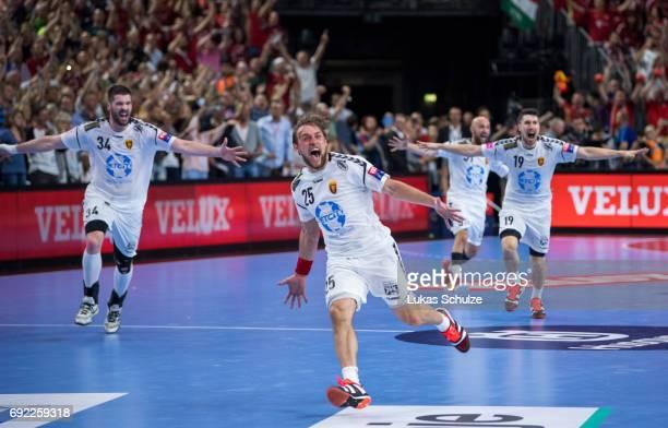 Luka Cindric and Vuko Borozan of Vardar celebrate after winning the VELUX EHF FINAL4 Final match between Paris SaintGermain Handball and HC Vardar at...